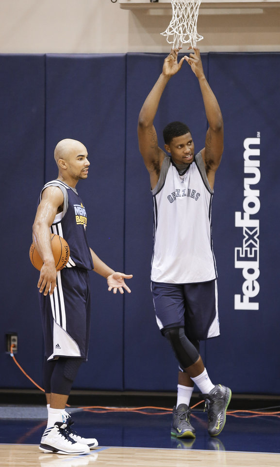 Memphis Grizzlies guard Jerryd Bayless, left, talks with forward Rudy Gay during NBA basketball practice on Tuesday, Oct. 2, 2012, in Memphis, Tenn. (AP Photo/Mark Humphrey)