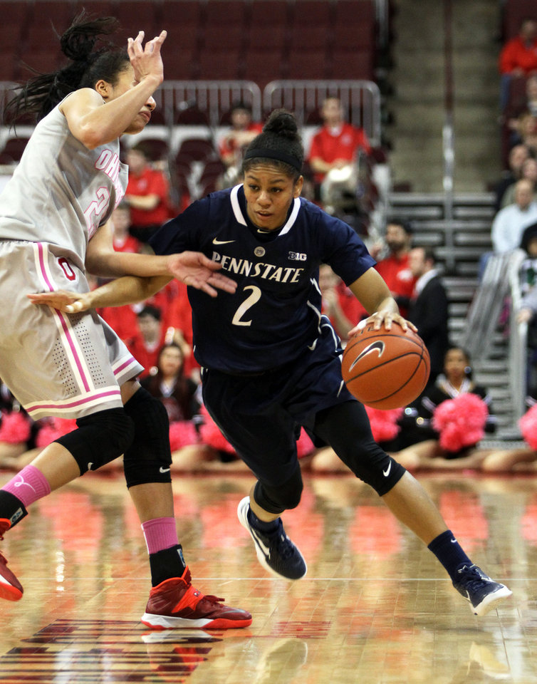 Photo - Ohio State's Martina Ellerbe tries to slow down Penn State's Dara Taylor (2) during the second half of an NCAA women's college basketball game, Sunday, Feb. 9, 2014, in Columbus, Ohio. Penn State won 74-54. (AP Photo/Mike Munden)