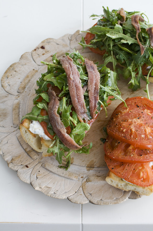 An open-faced anchovy sandwich with balsamic arugula. Matthew Mead - AP