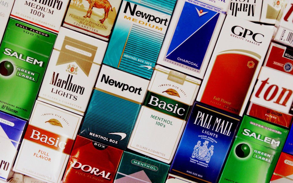 Photo - FILE - This Sept. 14, 2005 file photo shows packs of cigarettes in a store in Brunswick, Maine. It's no secret that smoking causes lung cancer. But what about diabetes, rheumatoid arthritis, erectile dysfunction? Fifty years into the war on smoking, scientists still are adding diseases to the long list of cigarettes' harms _ even as the government struggles to get more people to kick the habit. A new report from the U.S. Surgeon General's office says the nation is at a crossroads, celebrating decades of progress against the chief preventable killer but not yet poised to finish the job. (AP Photo/Pat Wellenbach, File)