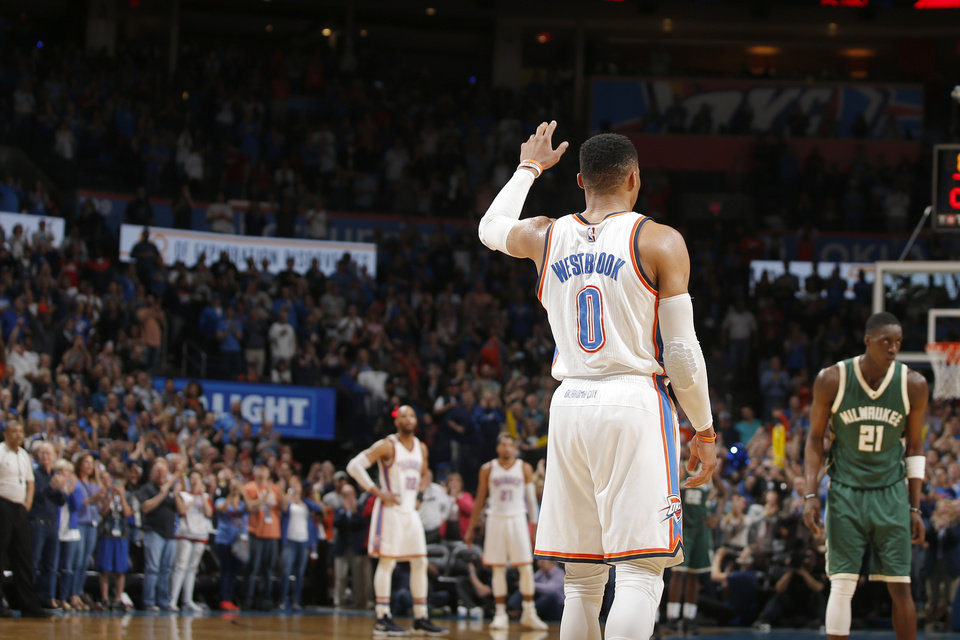 Photo - The crowd cheers for Oklahoma City's Russell Westbrook (0) after he Westbrook tied Oscar Robertson's single-season triple-double record during an NBA basketball game between the Oklahoma City Thunder and the Milwaukee Bucks at Chesapeake Energy Arena in Oklahoma City, Tuesday, April 4, 2017.  Photo by Bryan Terry, The Oklahoman