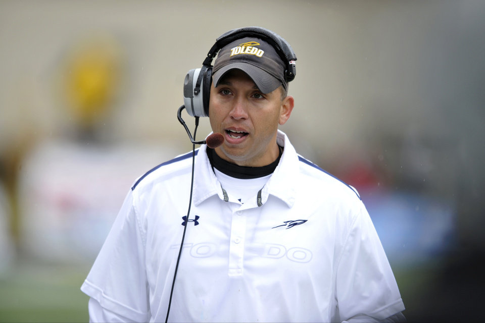 Photo - FILE - In this Oct. 19, 2013, file photo, Toledo head coach Matt Campbell talks during an NCAA college football game against Navy in Toledo, Ohio. Now that Chris Petersen has left Boise State for Washington, college football needs another coach from outside the so-called Big 5 conferences that will have his name come up for almost every big job. (AP Photo/David Richard, File)