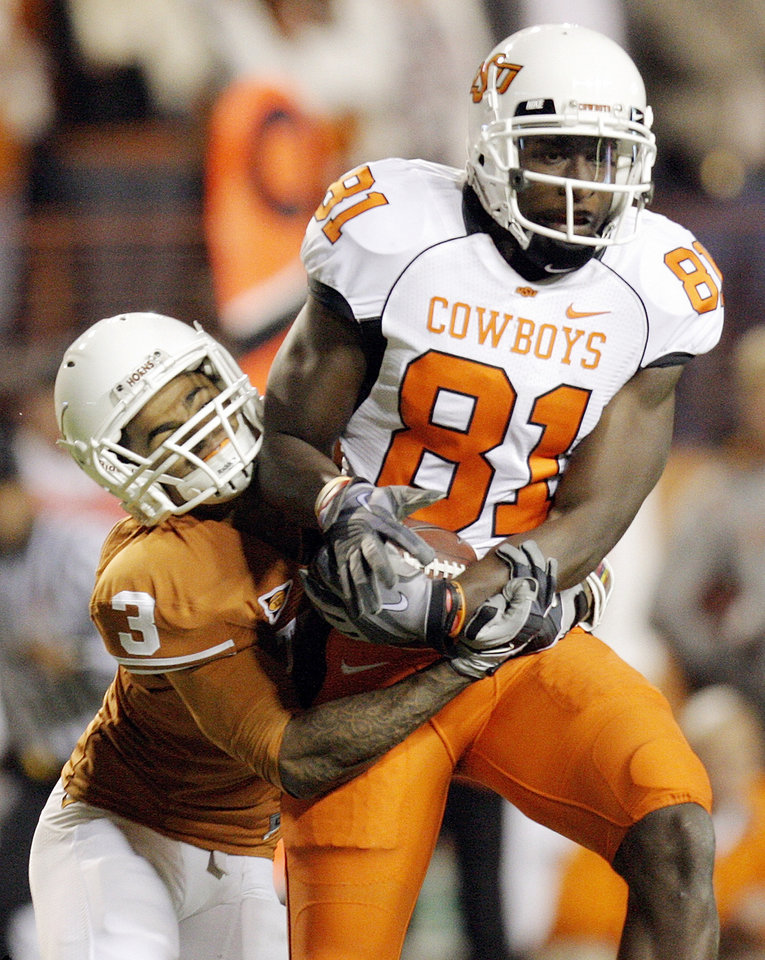 Photo - OSU's Justin Blackmon (81) makes a catch as Curtis Brown (3) of Texas defends in the first quarter during the college football game between the Oklahoma State University Cowboys (OSU) and the University of Texas Longhorns (UT) at Darrell K Royal-Texas Memorial Stadium in Austin, Texas, Saturday, November 13, 2010. Photo by Nate Billings, The Oklahoman