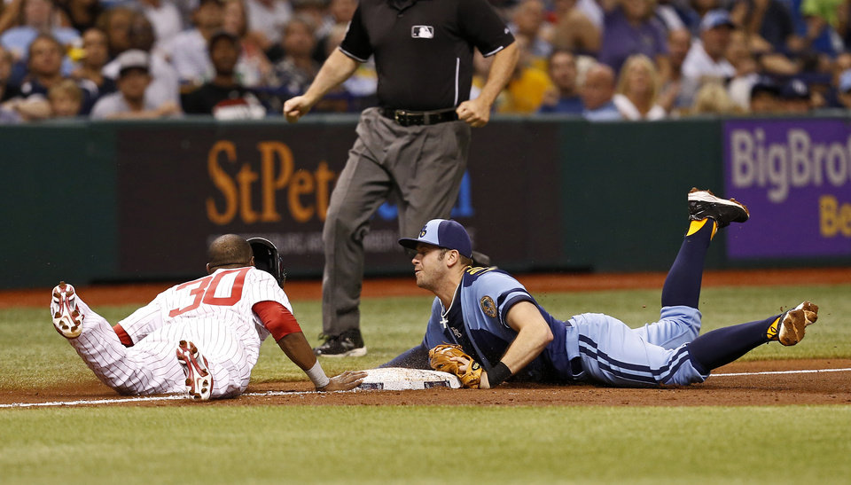 Photo - Tampa Bay Rays third baseman Evan Longoria, right, dives back to double up Chicago White Sox's Alejandro De Aza after catching a line drive from batter Alex Rios during the third inning of a baseball game Saturday, July 6, 2013, in St. Petersburg, Fla. (AP Photo/Mike Carlson)