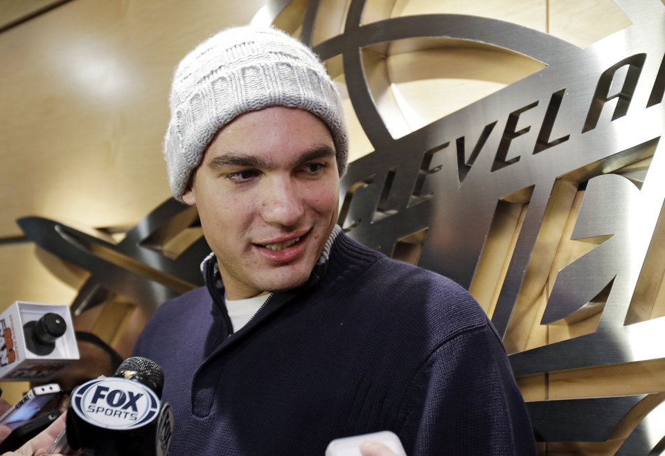 Cleveland Cavaliers\' Anderson Varejao, of Brazil, talks with reporters outside the locker room before an NBA basketball game against the Atlanta Hawks, Wednesday, Jan. 9, 2013, in Cleveland. Varajao needs surgery to repair a muscle that split near his right knee during a game against the Toronto Raptors on Dec. 18, and could cause him to miss two more months, a major setback for a young Cleveland team struggling through another miserable season. (AP Photo/Mark Duncan)
