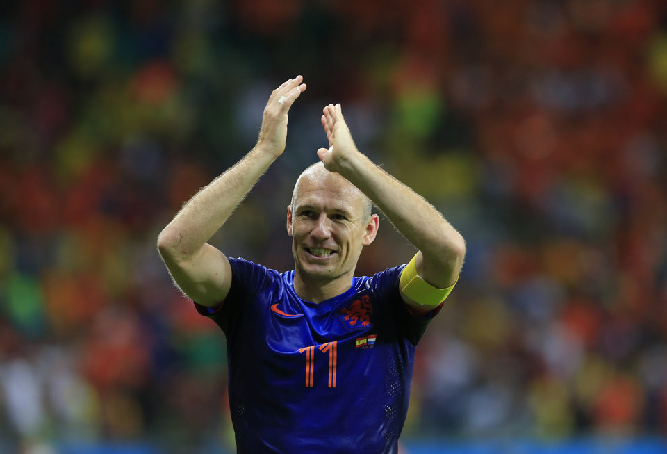 Photo - Netherlands' Arjen Robben applauds after the group B World Cup soccer match between Spain and the Netherlands at the Arena Ponte Nova in Salvador, Brazil, Friday, June 13, 2014.  The Netherlands won the match 5-1. (AP Photo/Bernat Armangue)