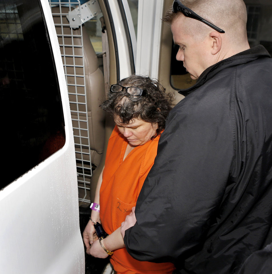 Photo - Kimberly Crain is placed into a sheriff's van behind the  Pottawatomie County Courthouse Wednesday afternoon, Jan. 9, 2013.  Prosecutors charged Gary Doby and Crain, a  former teacher at McLoud Elementary School, with sex crimes for allegedly photographing some of her female students in skimpy clothing and underwear.     Photo by Jim Beckel, The Oklahoman
