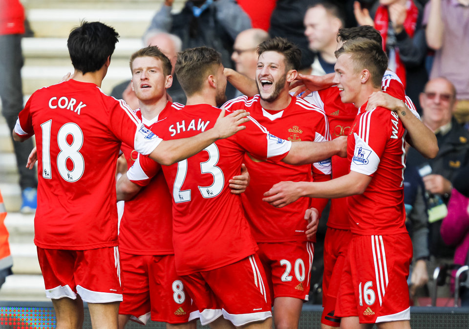 Photo - Southampton's Adam Lallana, center right, celebrates scoring the third goal past Newcastle United's Rob Elliot during their English Premier League soccer match at St Mary's, Southampton, England, Saturday, March 29, 2014. (AP Photo/Chris Ison, PA Wire)    UNITED KINGDOM OUT   -   NO SALES   -   NO ARCHIVES