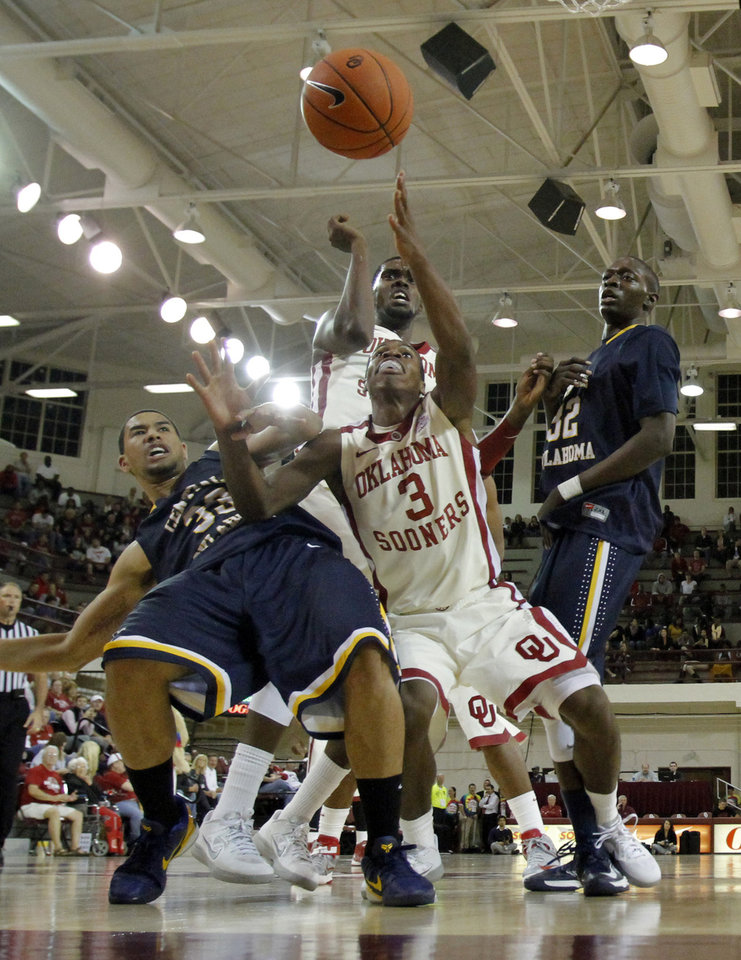 Buddy Hield (3) and Spencer Smith (33) fight for a ball as the University of Oklahoma (OU) Sooners men's basketball team defeats  the Central Oklahoma Bronchos 94-66 at McCasland Field House on Wednesday, Nov. 7, 2012  in Norman, Okla. Photo by Steve Sisney, The Oklahoman