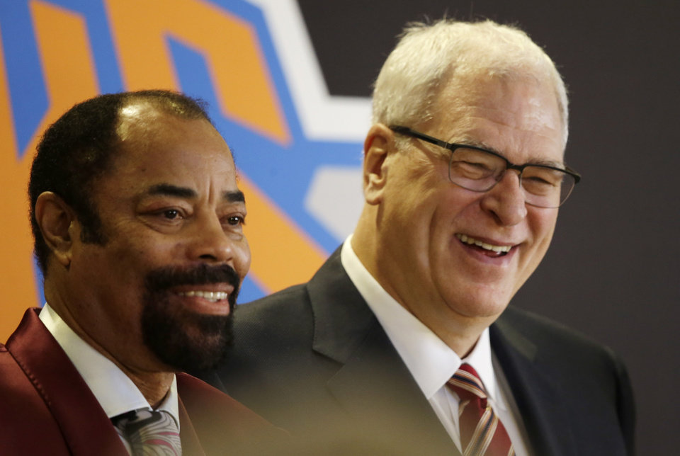 Photo - Former New York Knicks player Walt Frazier, left,  joins Phil Jackson, the newly named president of the Knicks, at a news conference Tuesday, March 18, 2014 in New York. Frazier and Jackson are former teammates with the Knicks. (AP Photo/Mark Lennihan)