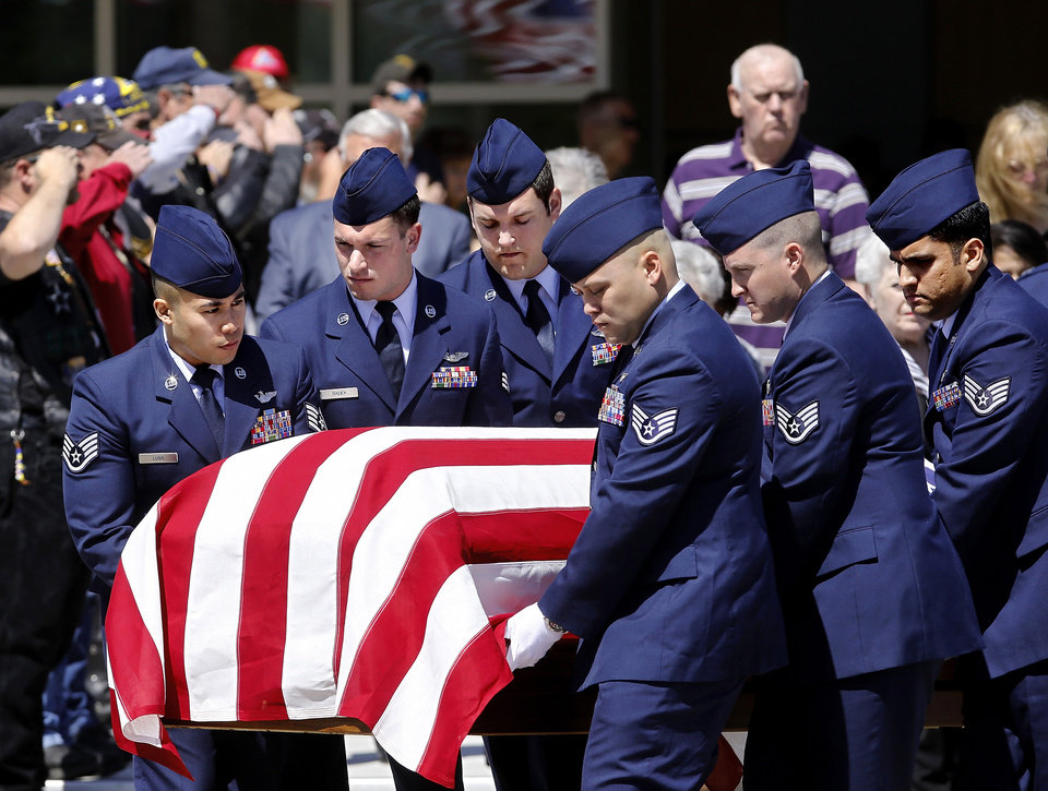 Photo - Fannin's casket is carried to a hearse after the service. More than 1,700 people, many of whom were dressed in the US Air Force's  dark blue service dress uniform, filled the lower and upper levels of the Rose State College Performing Arts Center Monday morning, May, 13, 2013, to attend a memorial service for SSgt. Daniel N. Fannin, a brother in arms killed April 27 in a plane crash while on a mission in Afghanistan.  Fannin , 30, was assigned to the 552nd Operations Support Squadron at Tinker Air Force base. He joined the Air Force in 2001. Photo  by Jim Beckel, The Oklahoman.