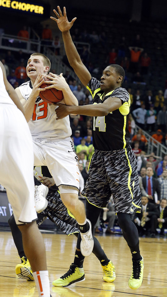 Oklahoma State\'s Phil Forte (13) is fouled in the final second of the Phillips 66 Big 12 Men\'s basketball championship tournament game between Oklahoma State University and Baylor at the Sprint Center in Kansas City, Thursday, March 14, 2013. Photo by Sarah Phipps, The Oklahoman