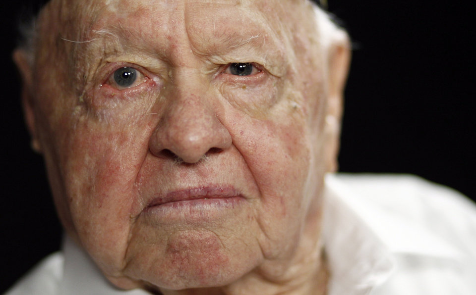 Photo - FILE - In this Thursday, May 19, 2011, file photo, actor Mickey Rooney poses during a portrait session in Los Angeles. Rooney, a Hollywood legend whose career spanned more than 80 years, has died. He was 93. Los Angeles Police Commander Andrew Smith said that Rooney was with his family when he died Sunday, April 6, 2014, at his North Hollywood home. (AP Photo/Matt Sayles, File)