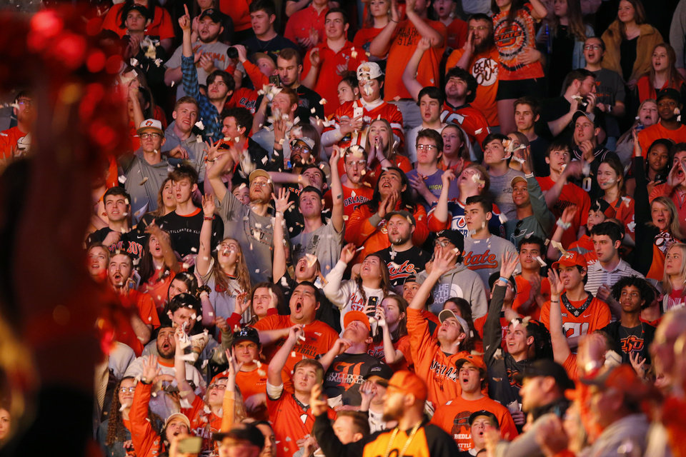 Photo - Oklahoma State fans cheer during introductions before an NCAA men's Bedlam basketball game between the Oklahoma State University Cowboys (OSU) and the University of Oklahoma Sooners (OU) at Gallagher-Iba Arena in Stillwater, Okla., Saturday, Feb. 22, 2020. Oklahoma State won 83-66. [Bryan Terry/The Oklahoman]