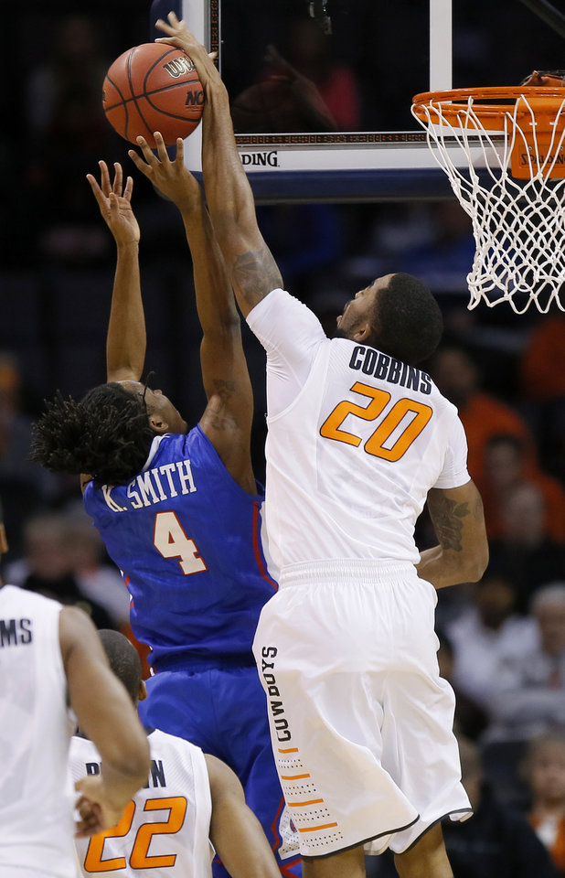 Photo - Oklahoma State's Michael Cobbins blocks the shot of Louisiana Tech's Kenneth Smith during the All-College Classic basketball game between Oklahoma State University and Louisiana Tech at Chesapeake Energy Arena in Oklahoma City, Okla., Saturday, Dec. 14, 2013. Photo by Bryan Terry, The Oklahoman