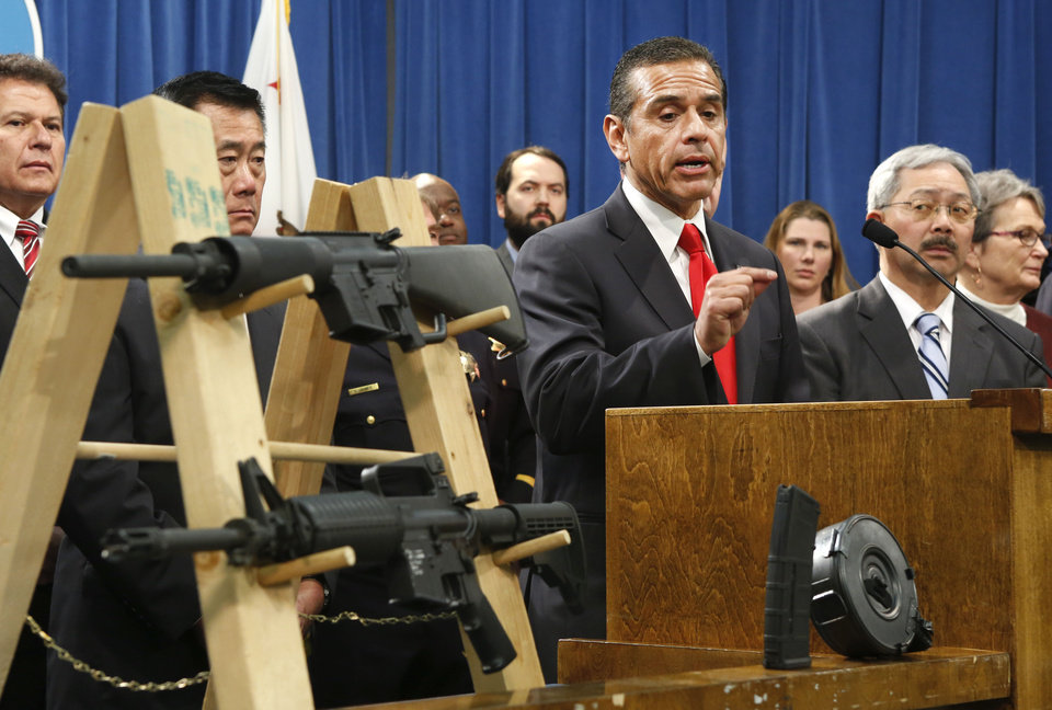 Photo - Los Angeles Mayor Antonio Villaraigosa, left,  discusses his support for a package of proposed gun control legislation at a Capitol news conference in Sacramento,  Calif., Thursday, Feb. 7, 2013.  Senate Democrats  unveiled a package of 10 proposed laws designed to close loopholes in existing gun regulations, keep firearms and ammunition out of the hands of dangerous person and strengthen education relating to firearms and gun ownership. Also seen are Sen. Marty Block, D-San Diego, left, Sen. Leland Yee, D-San Francisco, second from left, San Francisco Mayor Ed Lee, second from right and Sen. Loni Hancock, D-Berkeley, right. (AP Photo/Rich Pedroncelli)