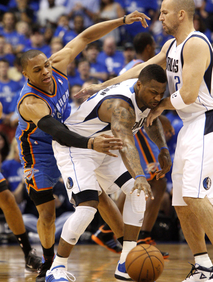 Photo - Oklahoma City's Russell Westbrook (0) goes for the ball beside DeShawn Stevenson (92) and Jason Kidd (2) of Dallas during game 5 of the Western Conference Finals in the NBA basketball playoffs between the Dallas Mavericks and the Oklahoma City Thunder at American Airlines Center in Dallas, Wednesday, May 25, 2011. Photo by Bryan Terry, The Oklahoman