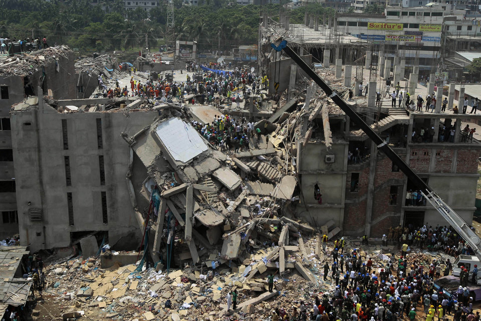 Photo - Bangladesh rescuers look for survivors and victims at the site of a building that collapsed Wednesday in Savar, near Dhaka, Bangladesh,Thursday, April 25, 2013. By Thursday, the death toll reached at least 194 people as rescuers continued to search for injured and missing, after a huge section of an eight-story building that housed several garment factories splintered into a pile of concrete. (AP Photo/A.M.Ahad)