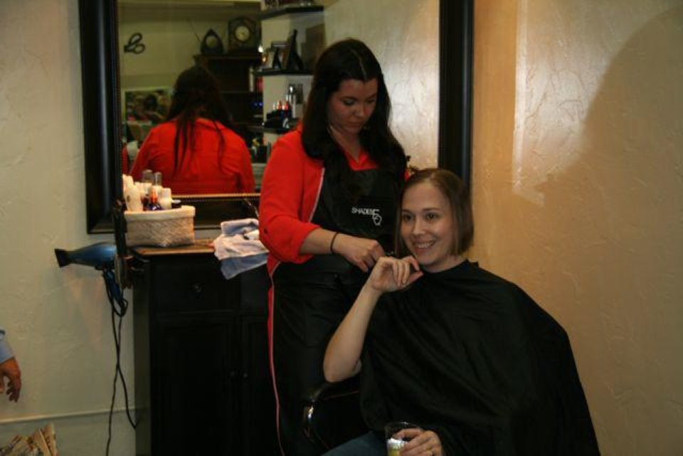 Photo - Katherine Milam styles Jenny Herzberger's hair before shaving it all off at a shave party between her second and third treatments of chemotherapy on April 16, 2013. PHOTO PROVIDED