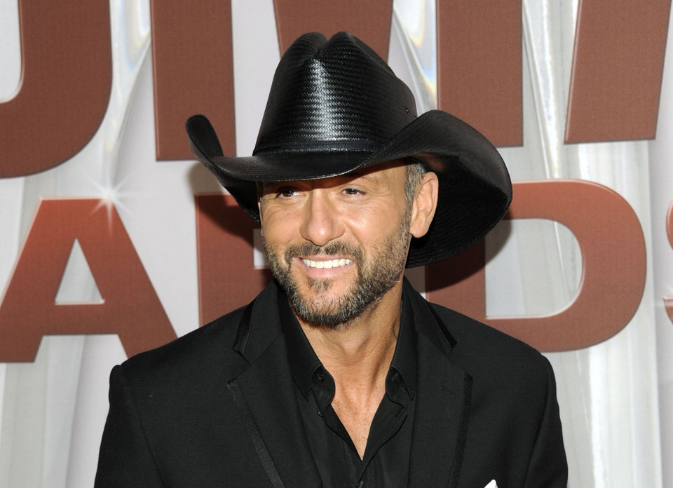 Photo - FILE - In this Nov. 9, 2011 file photo, country singer Tim McGraw arrives at the 45th Annual CMA Awards in Nashville, Tenn.   McGraw and Miranda Lambert are the top nominees for this year's Academy of Country Music Awards. Lambert and McGraw are up for seven awards apiece at the April 6 awards show. The nominations were announced Wednesday morning in a series of videos via social media.  (AP Photo/Evan Agostini, file)