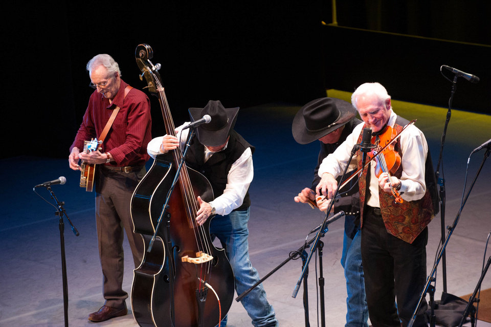 "From left, banjo player John Hickman, bass player Richard Sharpe, rhythm sticks percussionist Barry ""Bones"" Patton and Byron Berline perform in concert as the Byron Berline Band recently at the Armstrong Auditorium in Edmond. <strong>PHOTO BY MATT FRIESEN PROVIDED.</strong>"