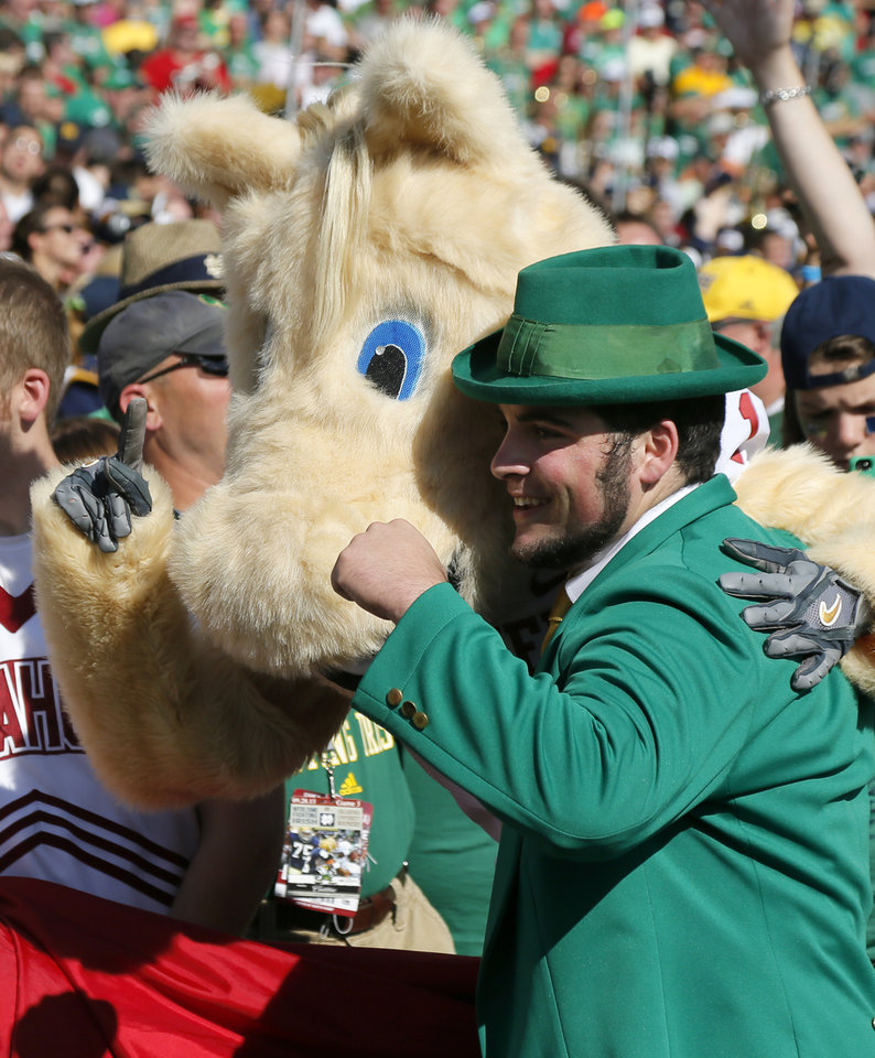 Photo - OU and Notre Dame mascots pose for a photo before a college football game between the University of Oklahoma Sooners and the Notre Dame Fighting Irish at Notre Dame Stadium in South Bend, Ind., Saturday, Sept. 28, 2013. Photo by Nate Billings, The Oklahoman