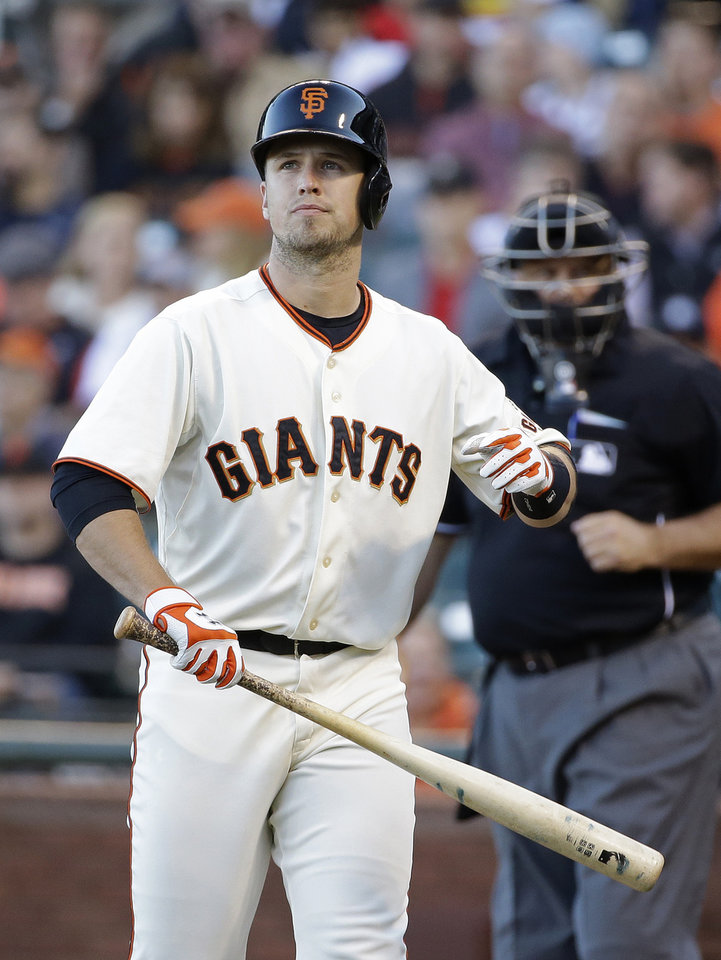 Photo - San Francisco Giants' Buster Posey walks back to the dugout after striking out against San Diego Padres starting pitcher Jesse Hahn in the first inning of their baseball game Tuesday, June 24, 2014, in San Francisco. (AP Photo/Eric Risberg)