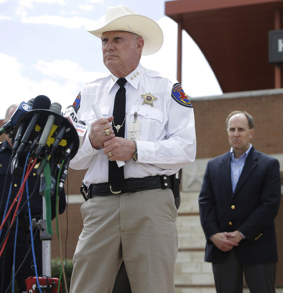 Photo - Kaufman County Sheriff David Byrnes speaks at a news conference, Sunday, March 31, 2013, in Kaufman, Texas. On Saturday, Kaufman County District Attorney Mike McLelland and his wife, Cynthia, were murdered in their home. (AP Photo/Mike Fuentes)