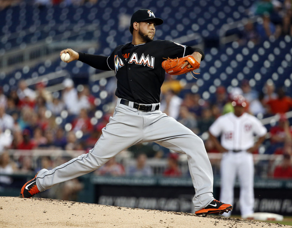 Photo - Miami Marlins starting pitcher Henderson Alvarez throws during the third inning of a baseball game against the Washington Nationals at Nationals Park, Wednesday, May 28, 2014, in Washington. (AP Photo/Alex Brandon)