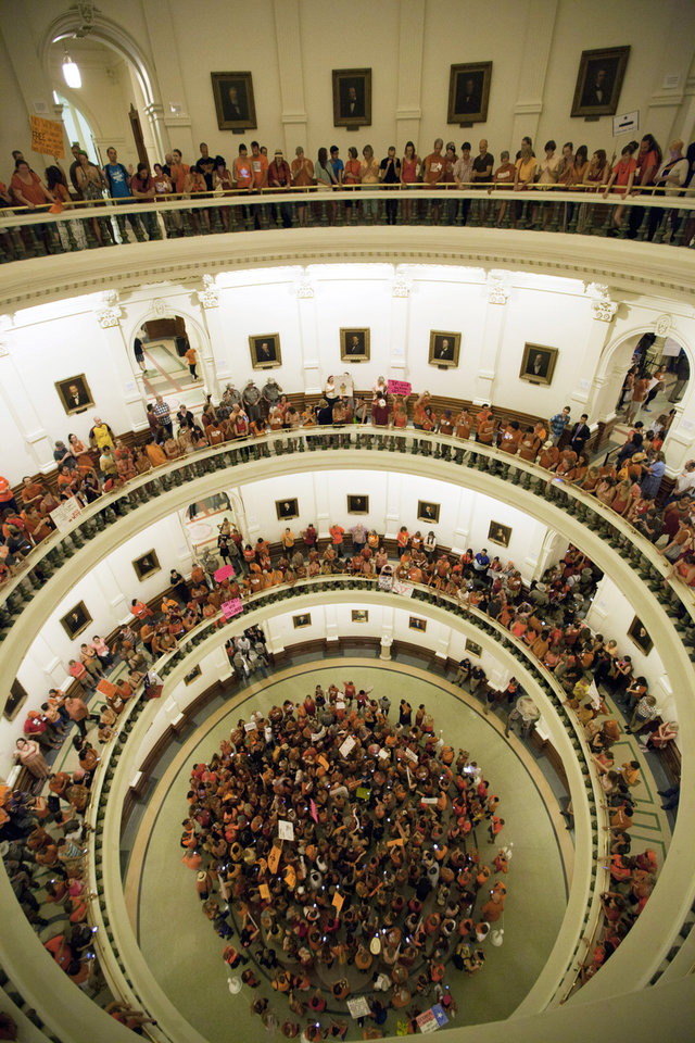Abortion rights advocates fill the rotunda of the State Capitol as the Senate nears the vote on Friday night, July 12, 2013. Texas senators were wrapping up debate on sweeping abortion restrictions Friday night and were poised to vote on a measure after weeks of protests. (AP Photo/Tamir Kalifa)