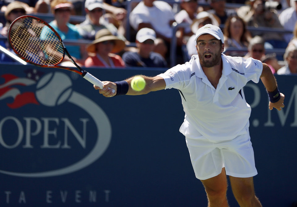 Photo - Pablo Andujar, of Spain, returns a shot to Kei Nishikori, of Japan, during the second round of the 2014 U.S. Open tennis tournament, Thursday, Aug. 28, 2014, in New York. (AP Photo/Matt Rourke)