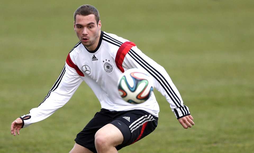 Photo - Germany's Pierre-Michel Lasogga practices during a training session prior to the international friendly soccer match between Germany and Chile in Stuttgart, southern Germany, Monday, March 3, 2014. Germany will face Chile Wednesday. (AP Photo/Matthias Schrader)