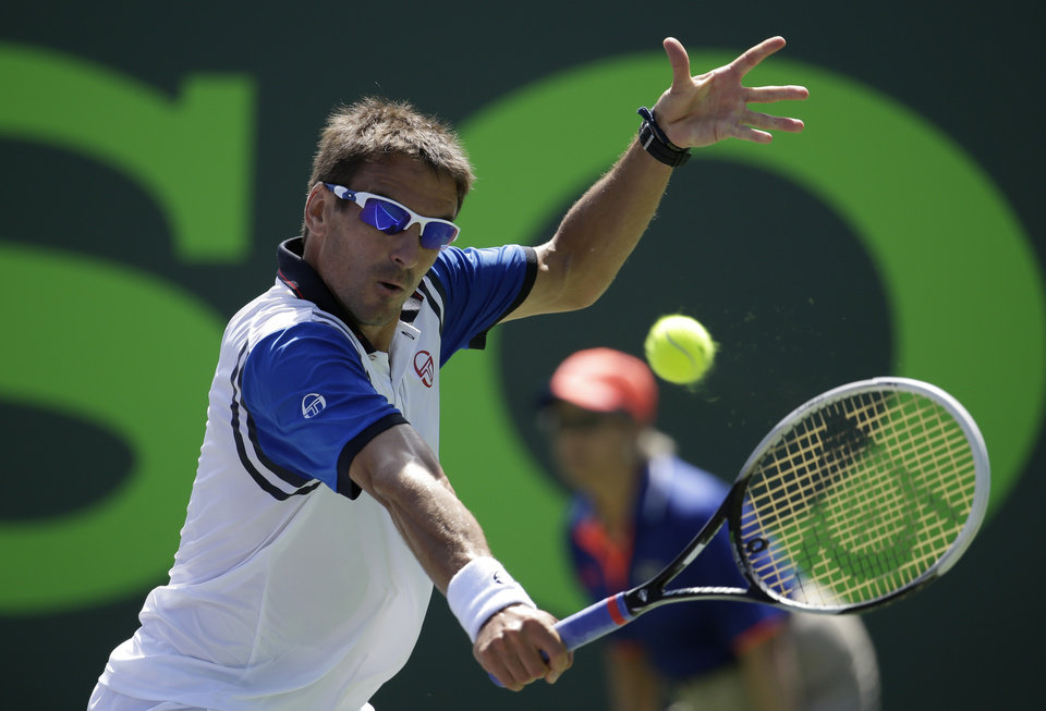 Photo - Tommy Robredo, of Spain, returns to Novak Djokovic at the Sony Open Tennis tournament, Tuesday, March 25, 2014, in Key Biscayne, Fla. (AP Photo/Lynne Sladky)