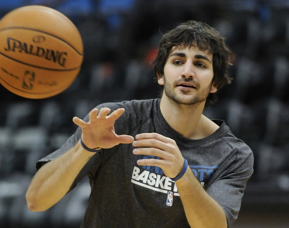 Photo - Minnesota Timberwolves' Ricky Rubio, of Spain, works out before an NBA basketball game against the Milwaukee Bucks, Friday, Nov. 30, 2012, in Minneapolis. Rubio, who suffered a torn ACL in a March 9 game, has been cleared to practice. (AP Photo/Jim Mone)