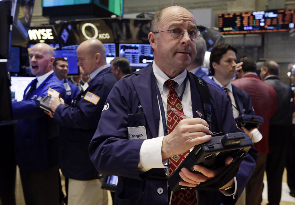 Photo - Trader Frederick Reimer, foreground, on the floor of the New York Stock Exchange, Thursday, April 3, 2014. Stocks indexes are edging higher as investors become more optimistic about the outlook for the U.S. economy. (AP Photo/Richard Drew)