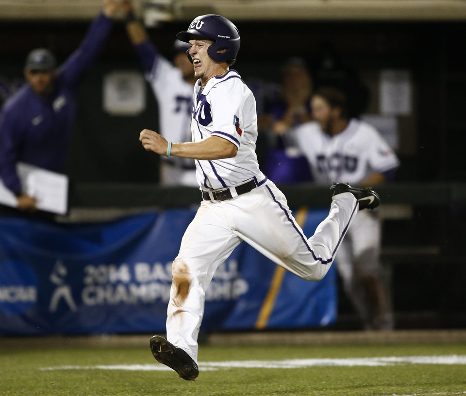 Photo - TCU's Cody Jones runs home on the game-winning hit by teammate Boomer White against Siena during an NCAA college baseball regional tournament game in Fort Worth, Texas, Friday, May 30, 2014. TCU won in eleven innings 2-1. (AP Photo/Jim Cowsert)