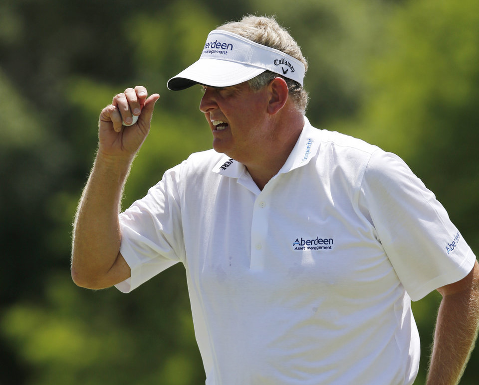 Photo - Colin Montgomerie gestures to the gallery following his putt on the second green during the final round of the U.S. Senior Open golf tournament at Oak Tree National in Edmond, Okla., Sunday, July 13, 2014. (AP Photo/Sue Ogrocki)