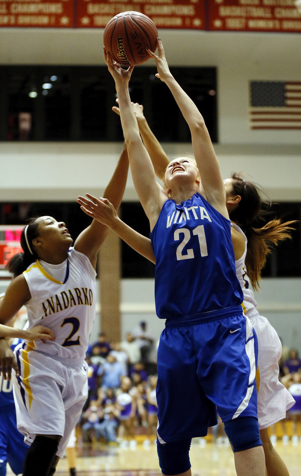 Vinita\'s Carsyn Spurgeon (21) grabs a rebound in front of Anadarko\'s Tandra King (2) during a Class 4A girls high school basketball game in the first round of the state tournament at the Sawyer Center on the campus of Southern Nazarene University in Bethany, Okla., Thursday, March 7, 2013. Photo by Nate Billings, The Oklahoman