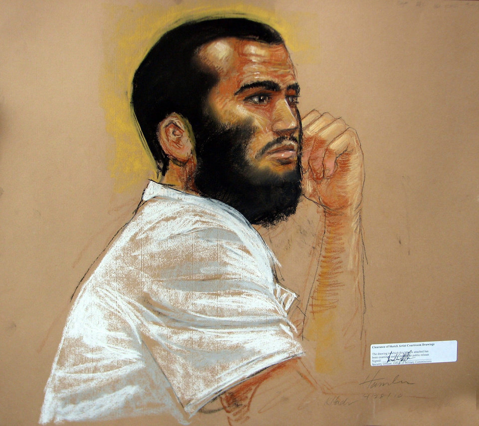Photo - FILE - In an April 28, 2010, file artists rendering, Canadian defendant Omar Khadr attends his hearing in the courthouse for the U.S. military war crimes commission at the Camp Justice compound on Guantanamo Bay U.S. Naval Base in Cuba. An American soldier blinded in Afghanistan and the widow of another soldier killed there have filed a $44.7 million wrongful death and injury lawsuit against a Canadian man who was held at Guantanamo Bay and pleaded guilty to committing war crimes when he was 15. Layne Morris of Utah and Tabitha Speer of North Carolina filed their lawsuit Friday, May 23, 2014, in federal court in Utah against Omar Khadr, who signed a plea deal in 2010 that he committed five war crimes, including the killing of U.S. soldier Christopher Speer, in 2002. As part of the deal, Khadr admitted to throwing the grenade that killed Speer and injured other soldiers, including Morris, who lost sight in one eye from the shrapnel, the lawsuit states. The Toronto-born Khadr is serving the remainder of his eight-year sentence in Canada. (AP Photo/The Canadian Press, Janet Hamlin, Pool, File)