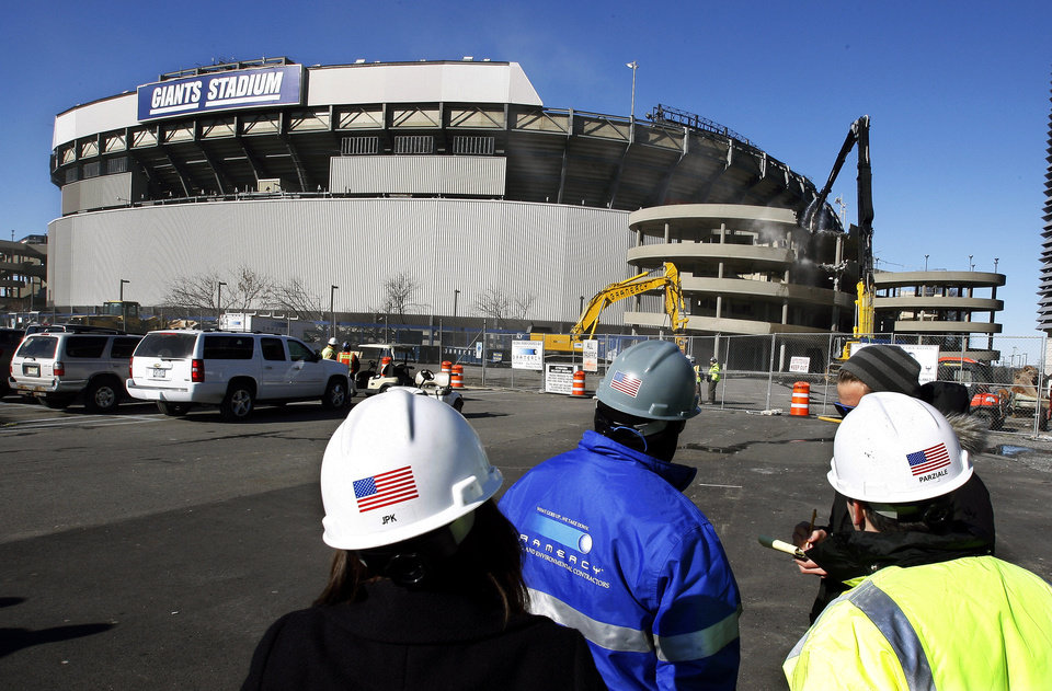 Photo -   FILE - This Feb. 4, 2010, file photo, workers watch as a machine begins the demolition of Giants Stadium, in East Rutherford, N.J. Self-described hit man Donald