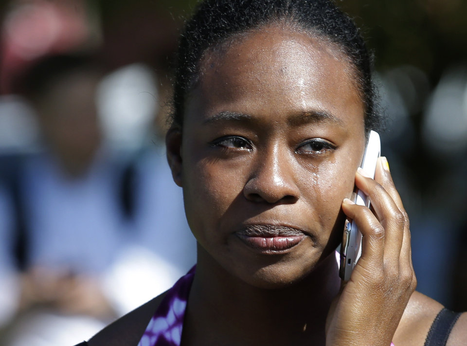 Photo - Brianna Clarke, a student at Seattle Pacific University, cries as she talks on her phone at the scene of a shooting Thursday, June 5, 2014 at Seattle Pacific University in Seattle. About 4,270 students attend the private Christian university, located in a residential neighborhood about 10 minutes from downtown Seattle. (AP Photo/Ted S. Warren)
