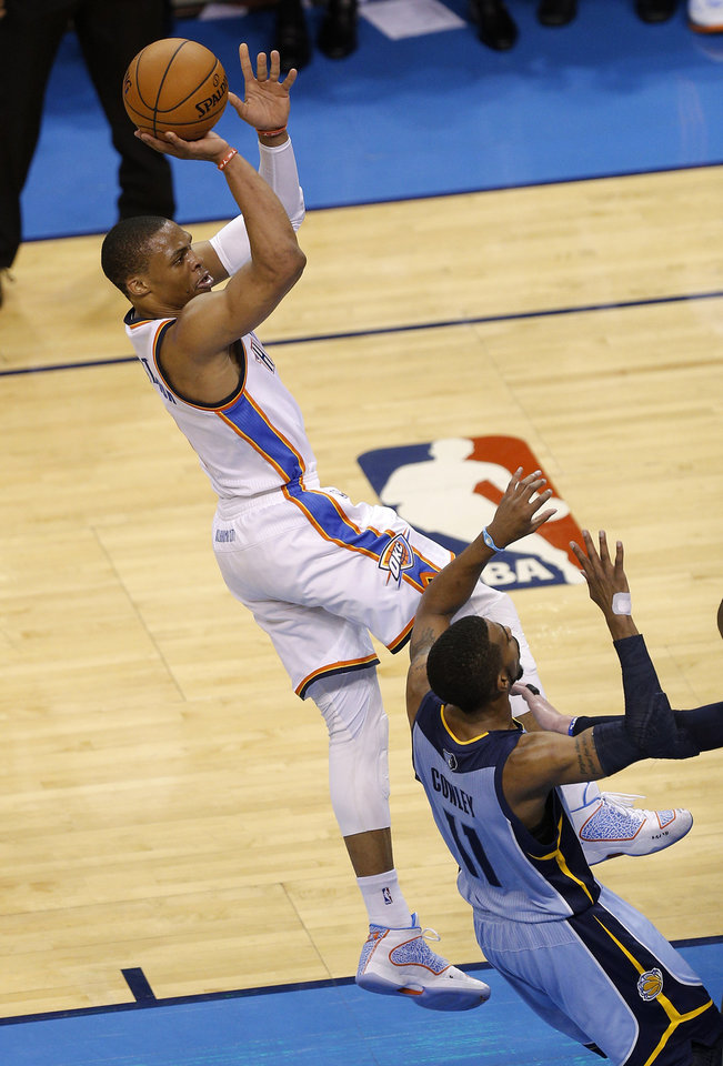 Photo - Oklahoma City's Russell Westbrook (0) shoots over Memphis' Mike Conley (11) during Game 7 in the first round of the NBA playoffs between the Oklahoma City Thunder and the Memphis Grizzlies at Chesapeake Energy Arena in Oklahoma City, Saturday, May 3, 2014. Photo by Sarah Phipps, The Oklahoman