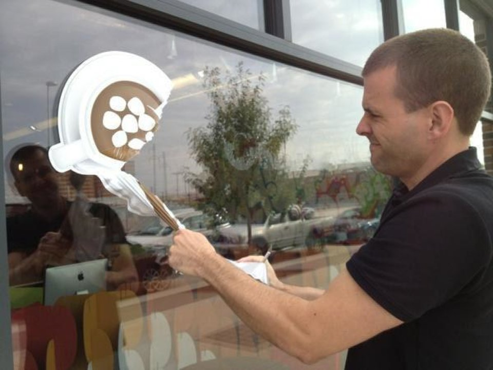 Oklahoma City Co-working Collaborative co-founder Derrick Parkhurst removes the group's storefront signage Monday after announcing it is closing its doors. <strong>Meaghan Hadley</strong>