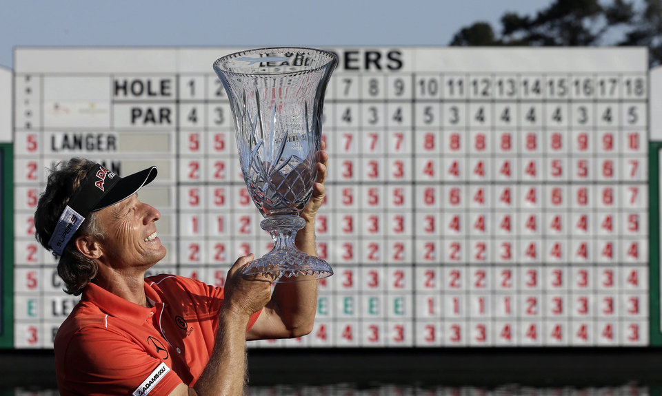 Photo - Bernhard Langer, of Germany, poses with the trophy after winning the Greater Gwinnett Championship golf tournament on Sunday, April 21, 2013, in Duluth, Ga. (AP Photo/John Bazemore)