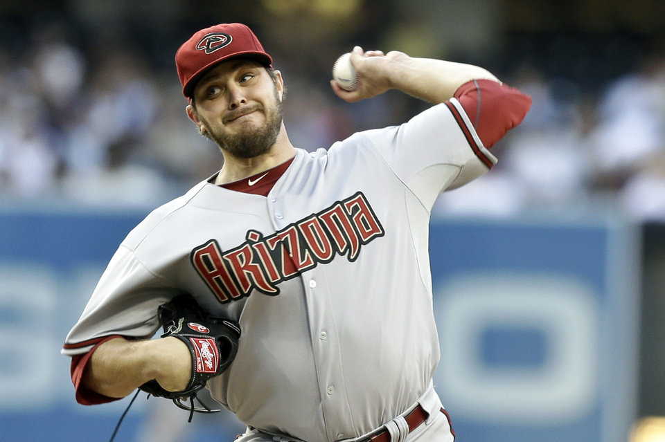 Photo - Arizona Diamondbacks starter Wade Miley works against the San Diego Padres in the first inning of a baseball game, Saturday, June 15, 2013 in San Diego. (AP Photo/Lenny Ignelzi)