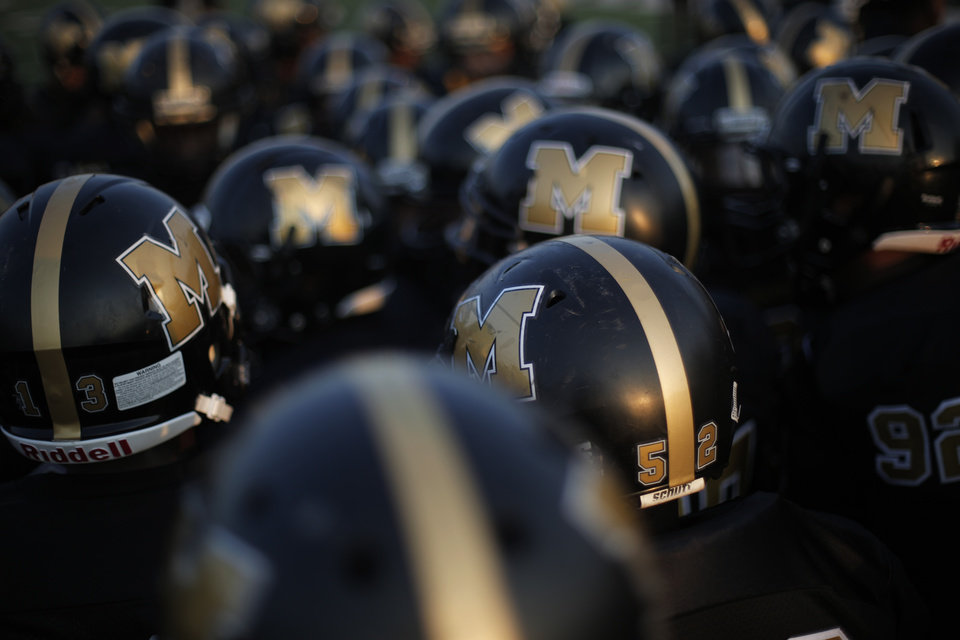 Photo - Midwest City huddles up before a high school football game between Midwest City and Norman North in Midwest City, Friday, Sept. 21, 2012.  Photo by Garett Fisbeck, The Oklahoman