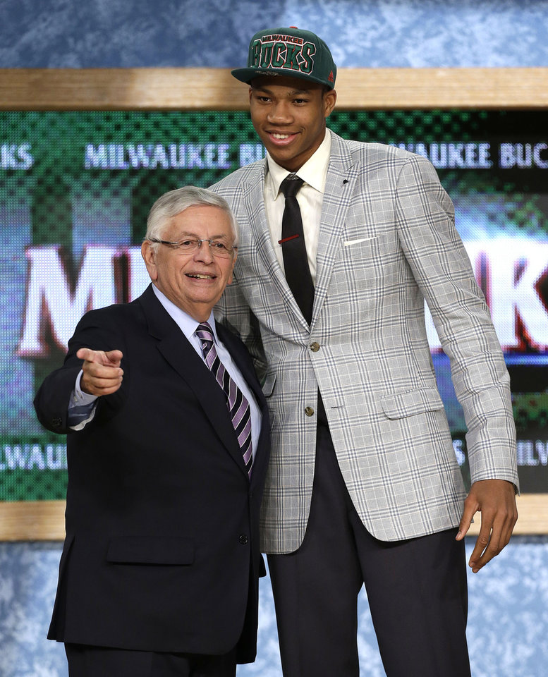 Photo - NBA Commissioner David Stern, left, stands with Giannis Antetokounmpo, of Greece, who was selected by the Milwaukee Bucks in the first round of the NBA basketball draft, Thursday, June 27, 2013, in New York. (AP Photo/Kathy Willens)