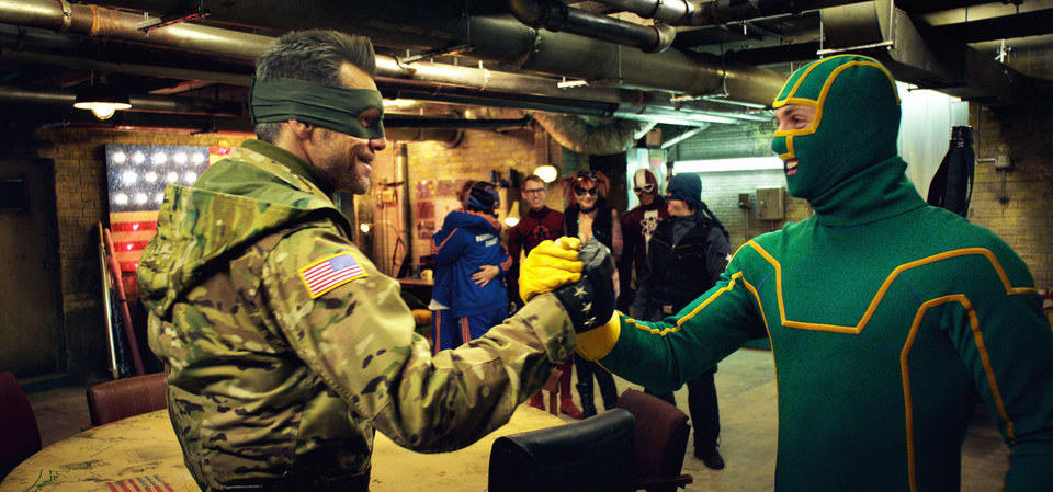 Photo - Jim Carrey, left, as Colonel Stars and Stripes makes a plan with Aaron Taylor-Johnson, as Kick-Ass, in a scene from the comedy film,