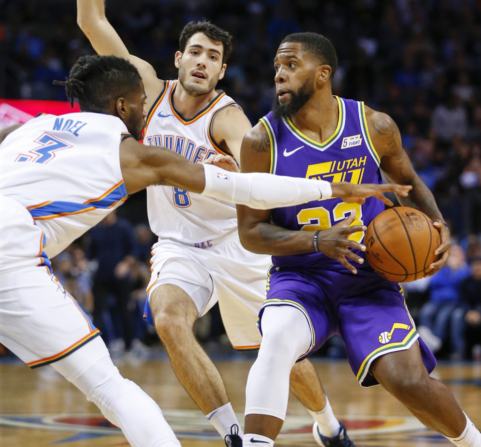 Photo - Oklahoma City's Nerlens Noel (3) and Alex Abrines (8) defend Utah's Royce O'Neale (23) during an NBA basketball game between the Utah Jazz and the Oklahoma City Thunder at Chesapeake Energy Arena in Oklahoma City, Monday, Dec. 10, 2018. Photo by Nate Billings, The Oklahoman