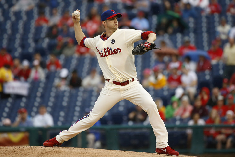Photo - Philadelphia Phillies' Kyle Kendrick pitches during the first inning of a baseball game against the San Diego Padres, Thursday, June 12, 2014, in Philadelphia. (AP Photo/Matt Slocum)